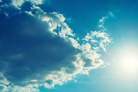 The sun shines bright in summer. Blue sky and clouds.- image Stockfoto