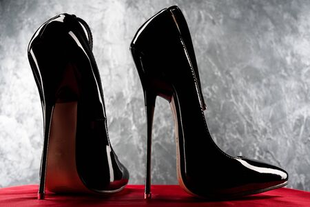 Black fetish shiny patent leather stiletto high heels with ankle strap - image
