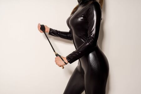 Adult sex games. Submissive girl in spandex catsuit waiting for punishment. spanking. bdsm theme. - image