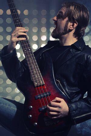 a bassist plays at a live concert Imagens