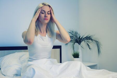 Depressed woman awake in the night, she is exhausted and suffering from insomnia - Image Stockfoto