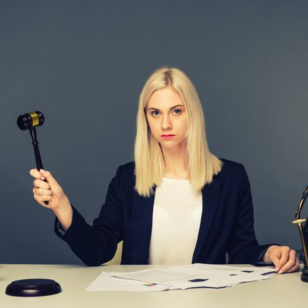 advice and justice concept. Justice scales, justice hammer and Litigation document, female lawyer working legal law with use laptop at lawyer office.