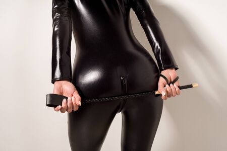 Adult sex games. Submissive girl in spandex catsuit waiting for punishment. spanking. bdsm theme. - image Standard-Bild - 143297743