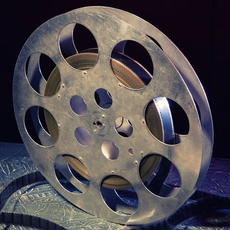 35 mm film reel with dramatic lighting on a dark background
