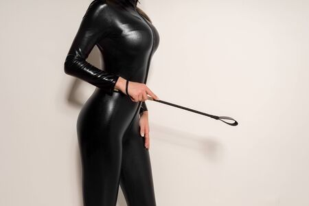 Adult games. Submissive girl in spandex catsuit waiting for punishment. spanking. theme. - image