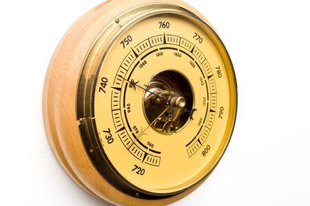 Vintage style barometer isolated on white wall background - image