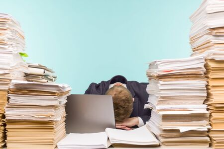 Close-up image of a stressful businessman tired from his work on the foreground - image Archivio Fotografico