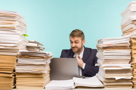 Business executive holds a video conference in the office and piles of paperwork, report for poorly done work - image