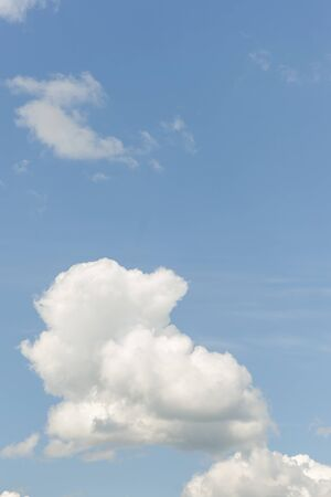 Blue summer sky white cumulus clouds background -image Standard-Bild - 150361690