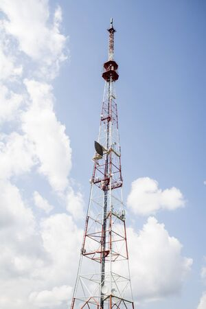 Telecommunication towers include of radio microwave and television antenna system with cloud blue sky . Standard-Bild - 150220189
