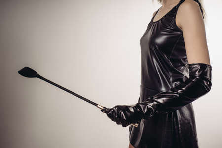 Lady Holding Strict Leather Short Handle Wide Head Riding Crop - image