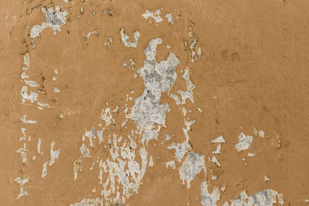 Close-up detail of cracked paint on rusty metal wall. - image