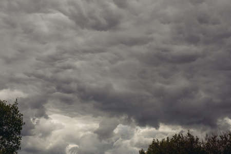 Dark clouds on sky before rainy and storm - image