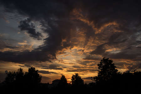 Dramatic sunset sky with yellow clouds