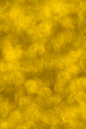 Abstract christmas lights glitter background. christmas gold texture background. Standard-Bild