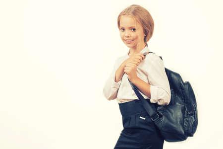 portrait of a smiling schoolgirl in uniform with school backpack - Image