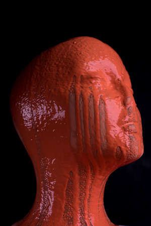The head of a female mannequin is doused with paint. Brain tumor and disease concept, alzheimer's disease or schizophrenia