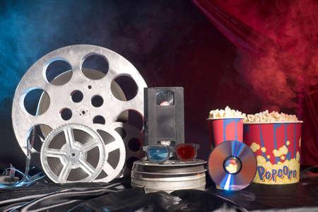 Old film reels, popcorn and 3d glasses on the table. Focus on glasses. Multicolored background. Evolution Film Media Zdjęcie Seryjne