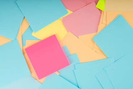 Pile of clear colorful paper notes. Closeup.