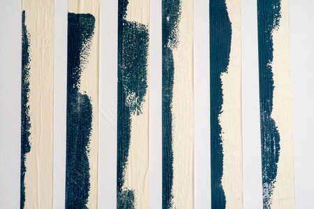 Strips of uses of masking tape along the edges of the paint.