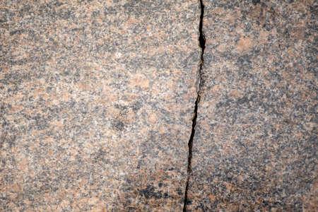 Cracked wall texture background, crack granite slab pattern
