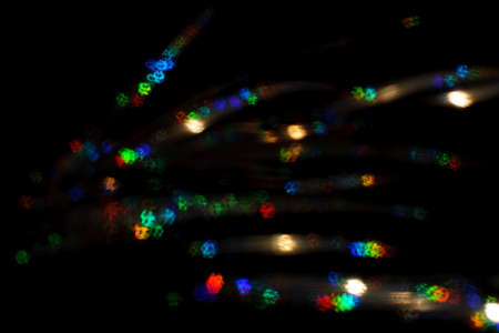 Christmas background. Festive abstract background with bokeh defocused lights and stars.