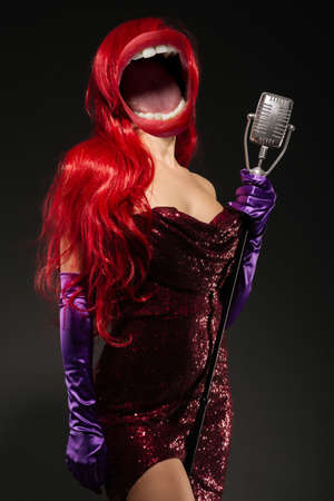 Collage of open mouth instead of a woman's head with very long hair in red gown with microphone on the stand on a black background. Sexy gown on a beautiful slim figure. Long pink gloves Zdjęcie Seryjne
