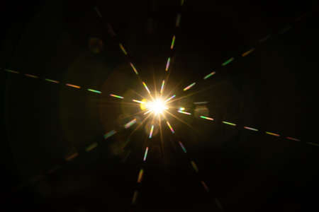 Abstract sun flare. The lens flare is subject to digital correction.