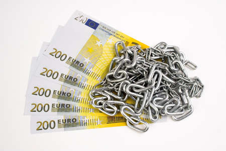 Money and chain isolated on white background.