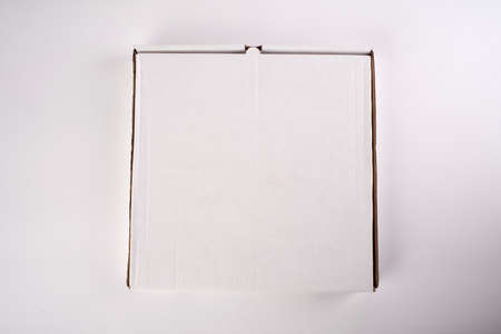close up of a white pizza box template on white background.