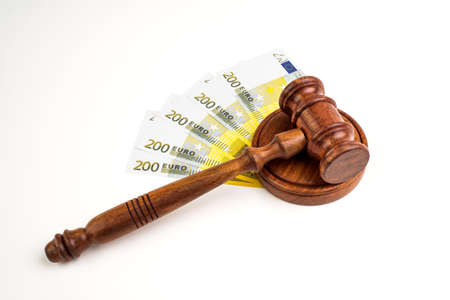 Judge's hammer gavel and Euro banknotes. Representation of corruption and bribery in the judiciary.