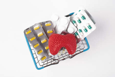 medicine blister in basket drug store sale customer with thyroid gland mockup on white background