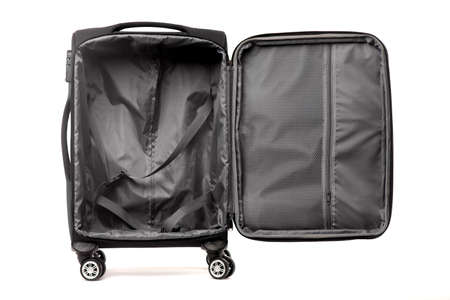 Travel open black suitcase isolated on white background.