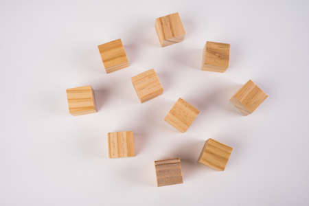 Row of ten blank wooden blocks on a white background with copyspace for your text, letters or numbers. 免版税图像