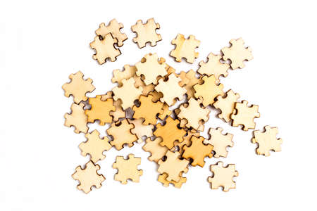 Wooden elements of a puzzle on a white background.