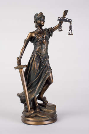 Lady Justice statue is the Greek ancient goddess.Themis a symbol of justice isolated on white. 免版税图像