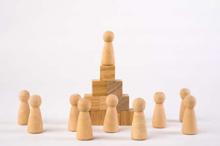 Chess figures and toy wooden ladder, concept to symbolize achievement, growth and success.