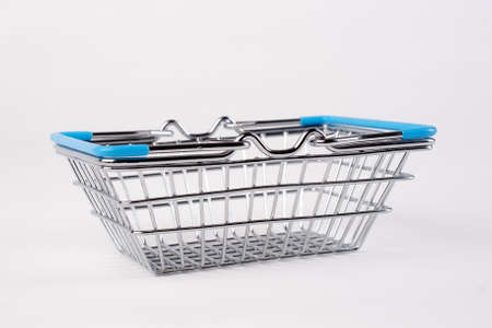 Empty grocery shopping basket. Isolated over white background.