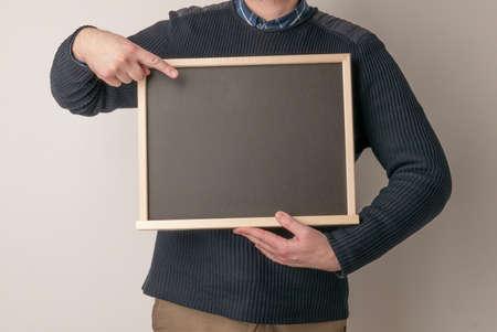 beautiful man pointing on blank chalk blackboard on white background 免版税图像