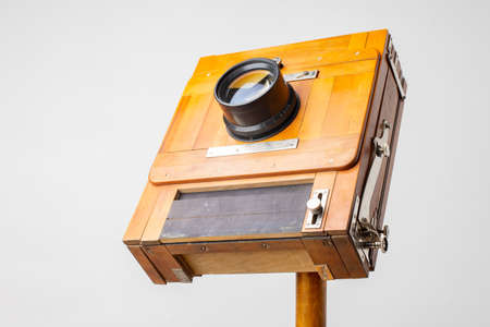 An old wooden camera of the last century with an accordion.