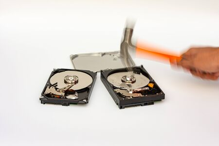 Destroy hard disk platter with hammer, security concept, motion blur effect. Stock fotó