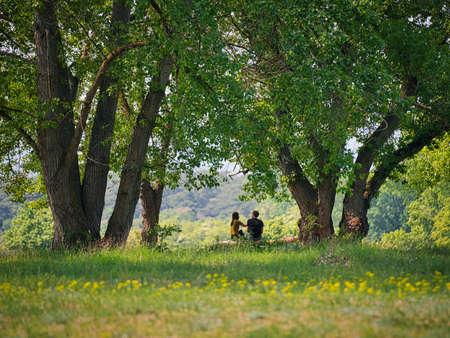 Sitting Together Standard-Bild