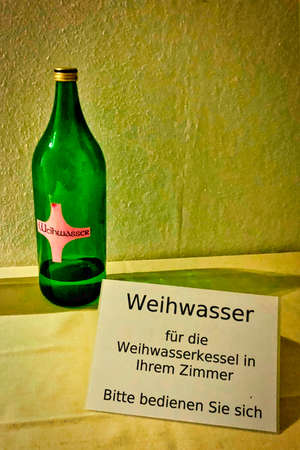 A bottle of holy water for self-service in your room = catholic humor.