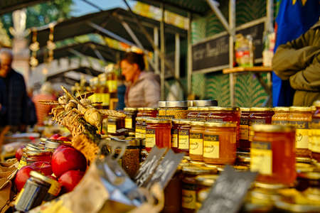 A local market with local products. Honey in different flavors is sold. Standard-Bild