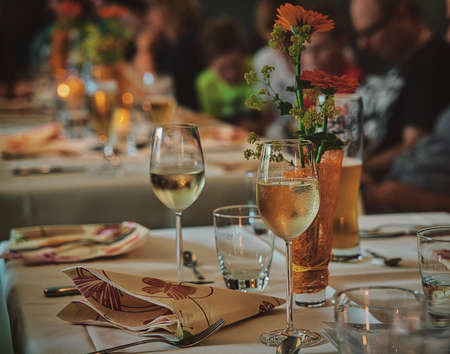 People celebrating together, wine and beer are on the table
