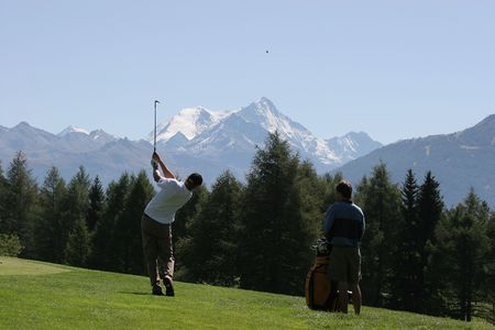 caddie: golf swing in Crans-Montana, Switzerland Stock Photo