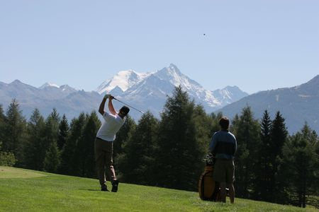 golf swing in Crans-Montana, Switzerland Stock Photo