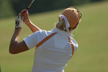 golf lady swing at finish