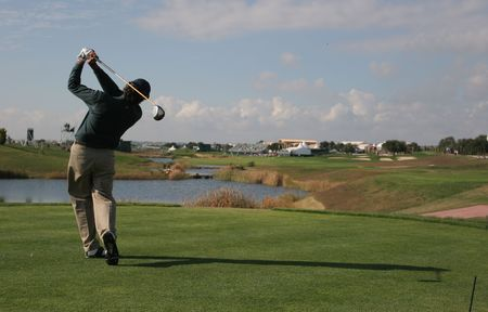 ヴィラモウラでゴルフのスイング 写真素材