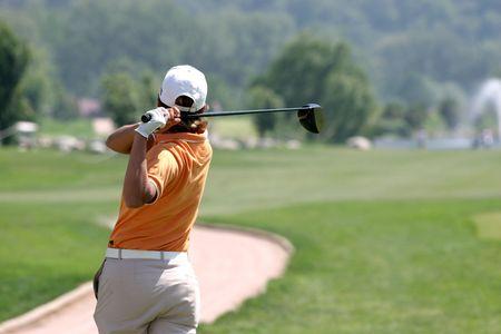 女性のゴルフ スイング 写真素材